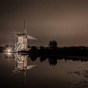 Die Windmühlen von Kinderdijk in den Abend sur John Ouwens
