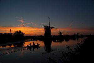 Molens bij zonsondergang in Kinderdijk van