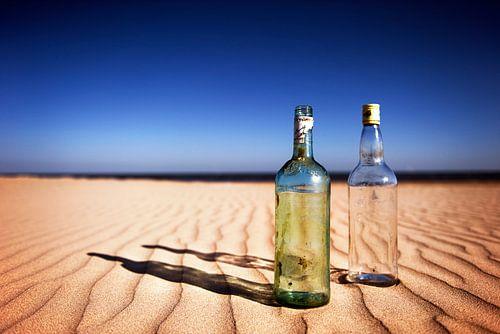 Bottles on sand......