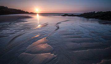 Zonsondergang bij eb op het strand van Jeroen Kleverwal