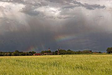 Regenboog tijdens een storm van Rolf Pötsch