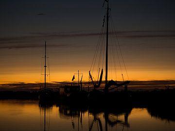 Zonsondergang op het water van Michel Aalders