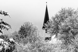 German village church in the snow (black and white)