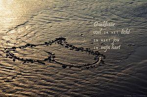 Een hart in het zand