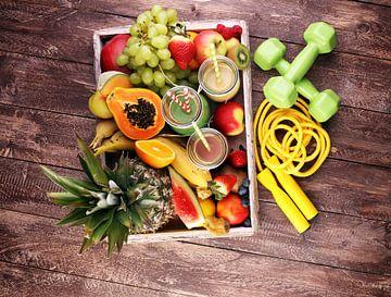 Gezond leefstijlconcept met sportuitrusting en flessen fruitsappen van Beats