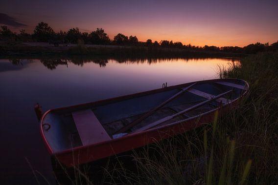 Roeien bij zonsondergang