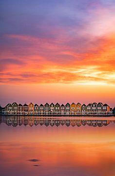 Chalets à Houten avec coucher de soleil et réflexion sur vedar cvetanovic