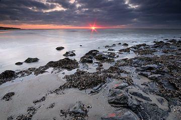 Zonsondergang op het strand von Antwan Janssen