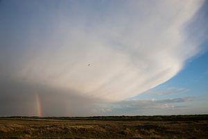 Cumulonimbus met regenboog boven de Geul