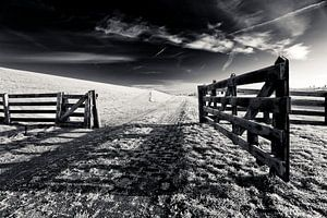 Geopend hek van