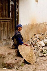 Chinese vrouw met rijsthoed van