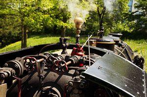 Cab of a historic steam train.