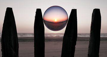 Lensball sunset at Bloemendaal van Sanneke van den Berg