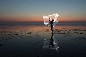 Licht harp op de waddenzee door een light paint