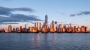 New york city skyline daytime sun clouds blue golden hour