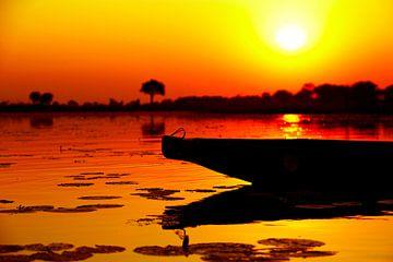 Afrikaanse zonsondergang mokoro van Dexter Reijsmeijer