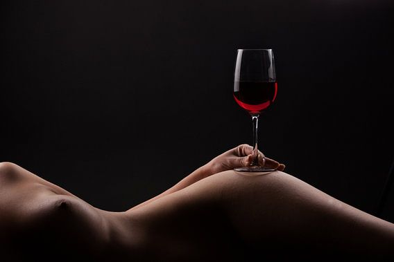 Red wine on a woman body