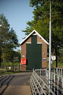 Een klein stuwhuisje van Kristian Oosterveen