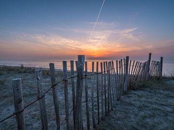 Zonsondergang aan de maasvlakte van Chris Es, van