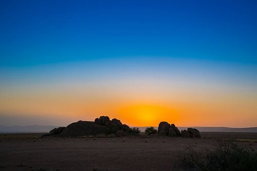 Ondergaande zon in de Namib woestijn, Namibië
