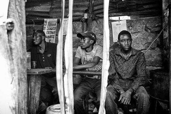 Three man in a bar in Kibera