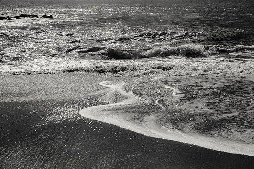 Wanneer het water het strand bereikt van