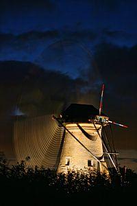 Dutch windmill at sunset. Kinderdijk The Netherlands
