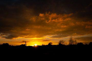 Vurige zonsondergang sur Niki Moens