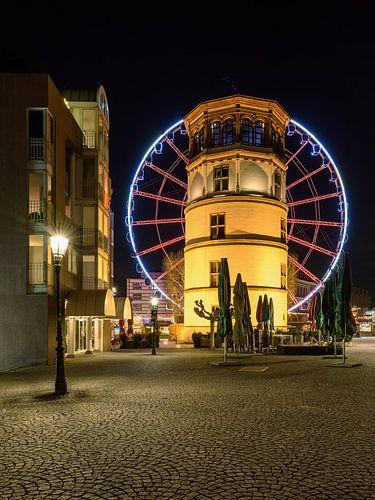 Castle tower in Dusseldorf and red ferris wheel van