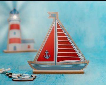 Zeilboot en vuurtoren in kleur