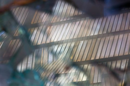 reflections in broken glas van