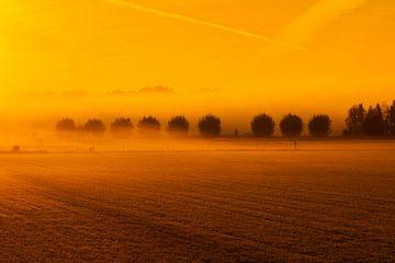 zonsopgang in een mistige morgen van eric brouwer