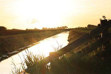 Nederland, zonsondergang van Evita Pierik