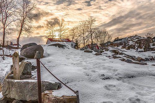 Huisje in de sneeuw van