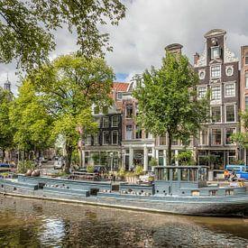 Woonboot in de Amsterdamse Grachten sur John Kreukniet