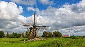Poldermolen in een Hollands landschap sur
