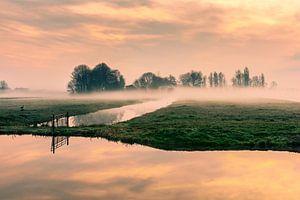 Zonsopkomst in de polder van