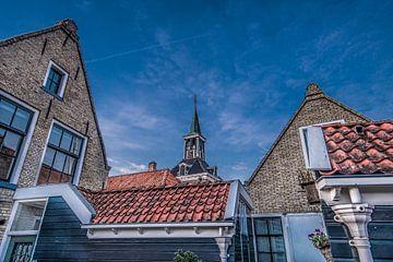 Zonsondergang in Makkum boven de daken van het stadje von Harrie Muis