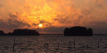Sunrise over Dutch waters van Arjan van de Logt