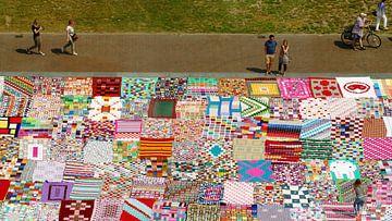 Haakkleed tapijt van R. Khoenie