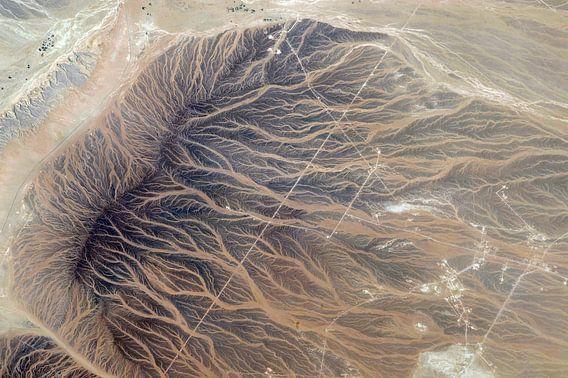 Afdrukken van het water in het zand, foto vanuit de ruimte. van Moondancer .