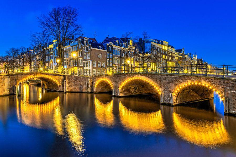 Keizersgracht / Reguliersgracht in Amsterdam van Bert Buijsrogge