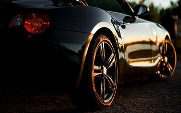Sonnenuntergangsreflexionen auf meinem Auto von Henri van Rheenen