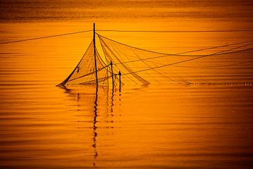 Visnetten bij zonsondergang sur Jurjen Veerman