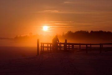 Radfahrer bei Sonnenuntergang von Sandra de Heij