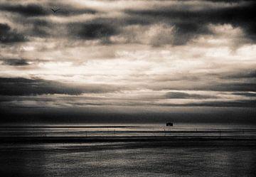 Wolkenlucht Waddenzee van