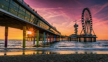 Zonnestralen onder de pier van René Rollema