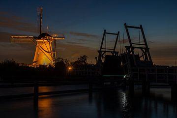 Verlichte molens in Kinderdijk van Bert van Wijk