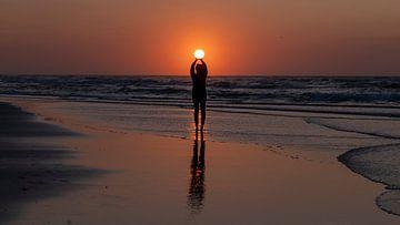 Silhouette van een vrouw met de zon van Wad of Wonders