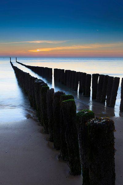 Palen in zee van gaps photography